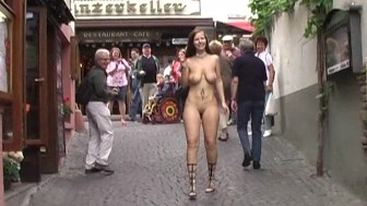 Crazy redhead shows her boobs in streets