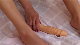 playing with my dildo with my feet