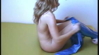 Redhead Rachel in blue latex