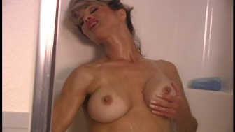 Shower time for horny blonde