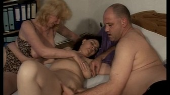 Lucky guy has two ladies playing with his penis
