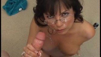 Brunette With Glasses Gives Handjob And Facial