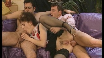 Sexy maid takes two cocks at one time