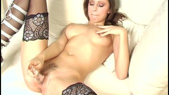 Brunette in stockings masturbates