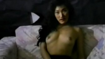 Asian hottie fucked on the couch