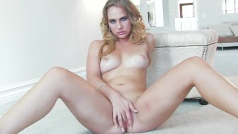 Petite stunner Katie Zane fingers her pink pussy for the camera
