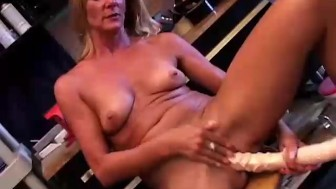 Sexy mature blonde in a tool belt