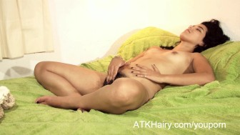 Hairy girl Faustina from Nicaragua plays with her pussy hair