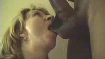 sexy cougar babe tries to stuff huge black cock in her mouth!