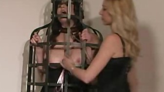 Dominatrix Does And Spanks Her Slaves