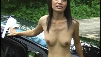 Asian hottie reveals her tits outside