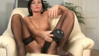 Paola fills her snatch with a huge dildo