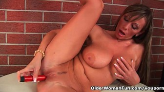 Mature milf with big tits and long legs fucks herself