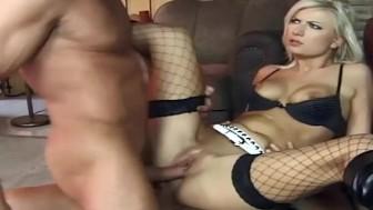 Blonde dped in black thigh high fishnet stockings