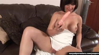Gorgeous British MILF dildos her pussy in sliky dress