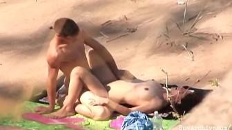 Voyeur video of a horny couple fucking