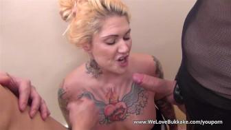 Tattooed punk gags while deepthroating