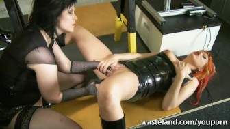 Lesbian Dominatrix fucks her girlfriend with sex toys in the dungeon