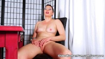 Short-haired mom rubs her shaved pussy