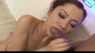 Reina Yoshii in gold lingerie gets cum from sucking two cocks