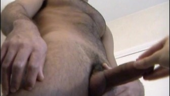 My neighbour made a porn: watch his huge cock gets wanked by a guy!