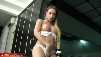Blue eyed sultry T-girl with red hair is masturbating