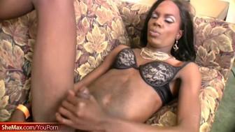 Dark skinned black T-girl eats cock and gets ass fingered