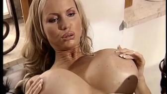 Big tits under the desk