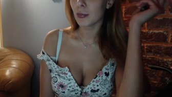Busty redhead looking for a man to play with..