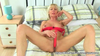 British gilf Elaine toys around with her dildo